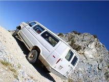Offroading #54. 4x4 van on steep incline, exaggerated camera angle Royalty Free Stock Image
