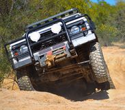 Offroading. A land rover defender offroading through an obsticle Royalty Free Stock Image