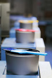 Offset cyan ink. Offset printing machine with cyan color ink can with spatula, portrait oriented photo stock images