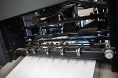 Detail of rollers in offset printing machine. Offset machine. Modern printing house Royalty Free Stock Photos