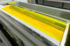 Offset machine printing press yellow ink rollers stock image