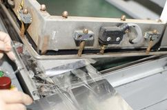 Offset machine roll foil laminator. Detail royalty free stock images