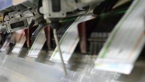 Offset magazine, brochure stitching process stock footage