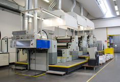 Offset press. Is a printing machine designed to produce fine quality reproductions. Offset printing is a widely used printing technique where the inked image is Stock Images