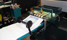 Offset press printing. Offset press is a printing machine designed to produce fine quality reproductions. Offset printing is a widely used printing technique stock images