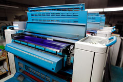 Offset printing machine. Blue group rollers Stock Photos
