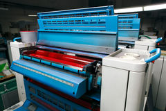 Offset printing machine. Magenta group rollers stock photography