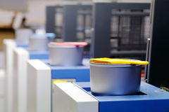 Offset printing machine - color ink cans Royalty Free Stock Photo