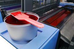 Offset printing machine - magenta ink. Offset printing machine with magenta color ink can with spatula stock photo