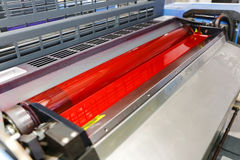 Offset printing machine - magenta ink. And ink ductor roller stock images