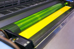Offset printing machine - yellow ink. And ink ductor roller stock photo
