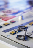 Offset printing work place with magnifying glass Stock Photos