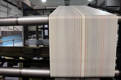 Offset trend printing. A large offset printing press running a long roll off paper at high speed royalty free stock photography
