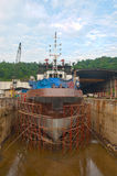 Offshore vessel at dry dock. Ing with canvas and manifolding royalty free stock photography