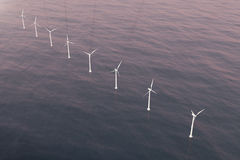 Offshore aerial view of wind turbines in the sea. Clean energy, ecological concept. 3d rendering vector illustration