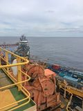 Offshore cargo operations. Between semisubmersible drilling rig and supply vessel Stock Image
