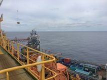 Offshore cargo operations. Between semisubmersible drilling rig and supply vessel Stock Photo