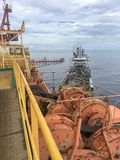 Offshore cargo operations. Between semisubmersible drilling rig and supply vessel Stock Images