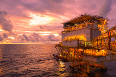 Offshore construction platform living quarter for production oil. And gas with bridge in evening time Stock Photography