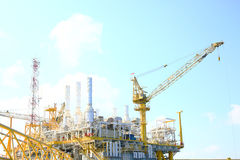 Offshore construction platform for production oil and gas. Oil and gas industry and hard work industry. Production platform Royalty Free Stock Image