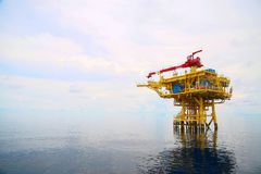 Offshore construction platform for production oil and gas. Oil and gas industry and hard work. Production platform and operation royalty free stock image