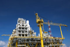 Offshore construction platform for production oil and gas, Oil and gas industry and hard work, Production platform and operation Royalty Free Stock Photos