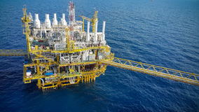 Offshore construction platform for production oil and gas, Oil and gas industry and hard work, Production platform and operation Stock Images