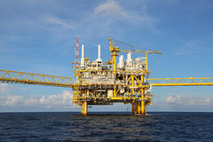Offshore construction platform for production oil and gas, Oil and gas industry and hard work, Production platform and operation Stock Photography