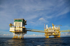 Offshore construction platform for production oil and gas, Oil and gas industry and hard work, Production platform and operation Royalty Free Stock Image