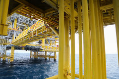 Offshore construction platform for production oil and gas, Oil and gas industry and hard work, Production platform and operation Stock Photo