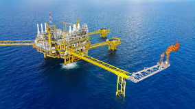 Offshore construction platform for production oil and gas, Oil and gas industry and hard work,Production platform and operation Stock Photo