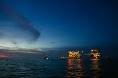 Offshore construction platform for production oil and gas, Oil and gas industry and hard work,Production platform and operation Royalty Free Stock Images
