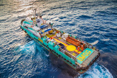 Offshore crew boat coming to receive passenger sent to work place. Stock Photo