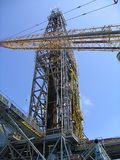 Offshore Derrick and Crane. Offshore Derrick with Crane lifting cargo Royalty Free Stock Photos