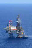The offshore drilling oil rig and supply boat side view Royalty Free Stock Photos