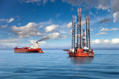 The offshore drilling oil rig. Oil rig and tanker ship on offshore area royalty free stock image
