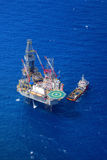 The offshore drilling oil rig top view from aircraft. Stock Photo