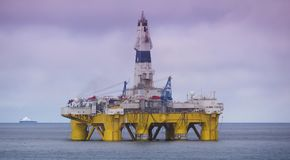 Offshore drilling rig in Gulf of Mexico, petroleum industry. Offshore drilling rig or platform in Gulf of Mexico, petroleum industry, with vessel royalty free stock photos