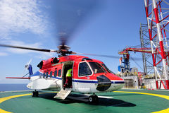 An offshore helicopter on the helideck Royalty Free Stock Images