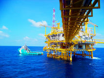 Offshore Industry oil and gas. Offshore oil and gas central process, Walking bridge link oil to gas platform, Petroleum industry stock photos
