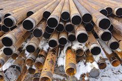 Offshore Industry oil and gas production petroleum pipeline. Downhole drilling rig. Laying the pipe on the deck. View of the shell. Of drill pipes laid in stock image