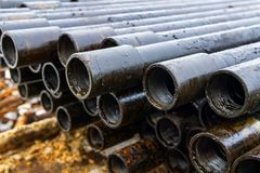 Offshore Industry oil and gas production petroleum pipeline. Downhole drilling rig. Laying the pipe on the deck. View of the shell. Of drill pipes laid in stock photos
