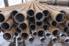 Offshore Industry oil and gas production petroleum pipeline. Downhole drilling rig. Laying the pipe on the deck. View of the shell. Of drill pipes laid in royalty free stock photography