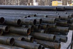 Offshore Industry oil and gas production petroleum pipeline. Downhole drilling rig. Laying the pipe on the deck. View of the shell. Of drill pipes laid in stock photography