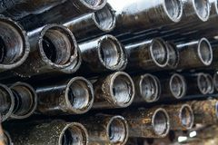 Offshore Industry oil and gas production petroleum pipeline. Downhole drilling rig. Laying the pipe on the deck. View of the shell. Of drill pipes laid in stock photo