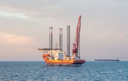 Offshore jack-up barge and an oil tanker Royalty Free Stock Images