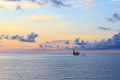 Offshore jack up drilling rig in the middle of the ocean Royalty Free Stock Photo
