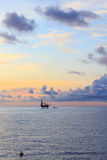 Offshore jack up drilling rig in the middle of the ocean Royalty Free Stock Photos
