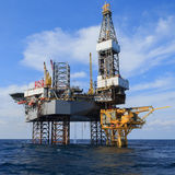 Offshore Jack Up Drilling Rig Over The Production Platform Stock Photos