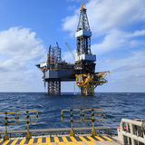 Offshore Jack Up Drilling Rig Over The Production Platform Royalty Free Stock Images